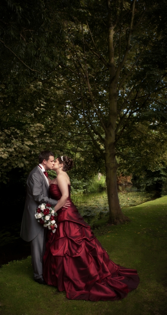 Kissing Married Couple Bride in Red Wedding Dress