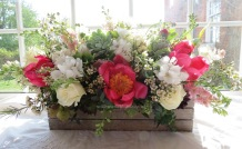 Vintage wedding crate with peonies, larkspur, roses, blossom and Succulents