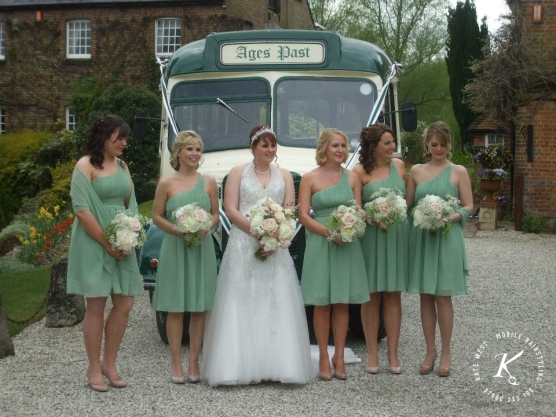 A collective of half up half down bridesmaids and also a full up curled bridal do.