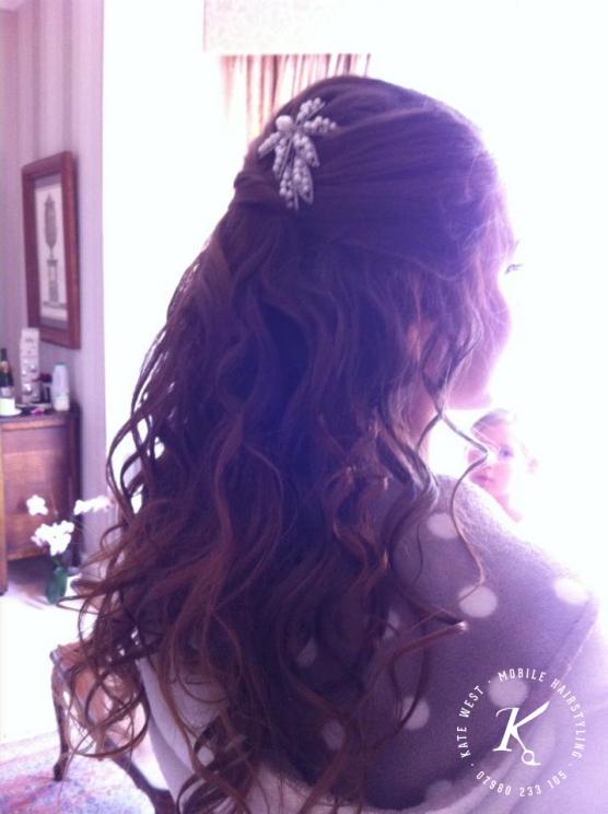 Loose half up half down bridal hair with twist top detail