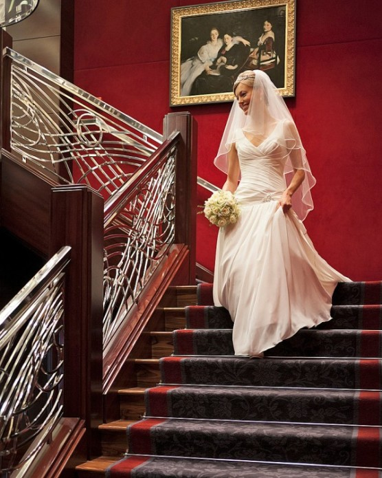 Bride Walking Down Luxurious Staircase at The Four Seasons Hotel London