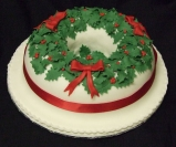 Holly and Bow Christmas Wreath Cake from Sweetness and Delight Wedding Cakes